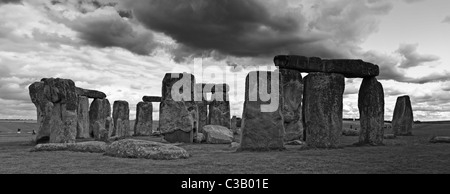 Dark clouds over Stonehenge, Black and white panorama - Stock Photo