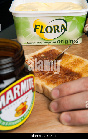 Illustrative image of Marmite and Flora Original spread, two Unilever food products. - Stock Photo