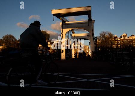 Bridge across Amstel River in Amsterdam - Stock Photo