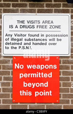 Sign outside  Hydebank Wood Young Offender's Centre, Belfast, informing visitors that the prison is a weapon and - Stock Photo