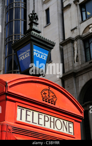 Red Telephone Box and Blue Metropolitan Police Lamp, Agar Street, London, England, UK - Stock Photo
