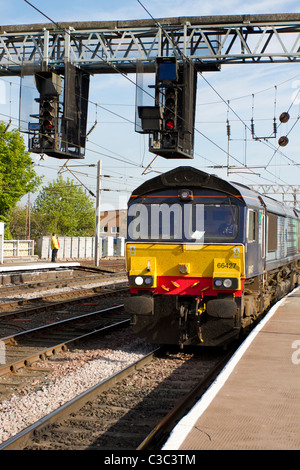 Power lines, and gantries for electric trains _ GB Freight Trains 66427 Frieght Train Cab _ LTS _ Class 66 DRS at - Stock Photo