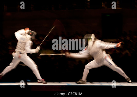 Blurred action of women's fencing competition at the 2008 Olympic Summer Games, Beijing, China - Stock Photo