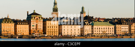 Panoramic view of Gamla Stan in Stockholm with Tyska Kyrkan and Storkyrkan at sunrise from Sodermalm. - Stock Photo