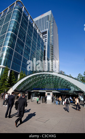 People entering and exiting Canary Wharf Tube Station, Docklands, London, England, UK - Stock Photo