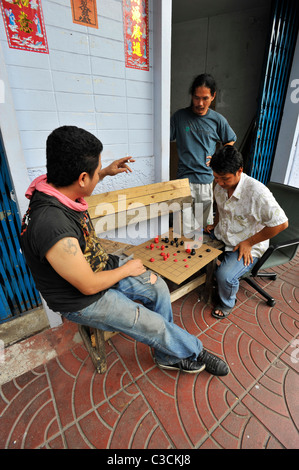 men playing chinese draughts , chinatown , bangkok, thailand - Stock Photo