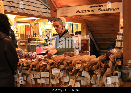 Amish woman selling local products at St. Jacobs farmers' market in Ontario Canada 2011 - Stock Photo