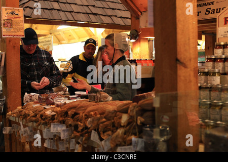 Amish woman selling sausage at St. Jacobs farmers' market in Ontario Canada 2011 - Stock Photo