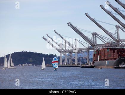 Sail boats and gantry cranes - Port of Oakland, California USA - Stock Photo