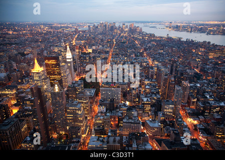 A twilight view from the Empire State Building towards Lower Manhattan, New York, USA. Tall buildings of fhe Financial - Stock Photo