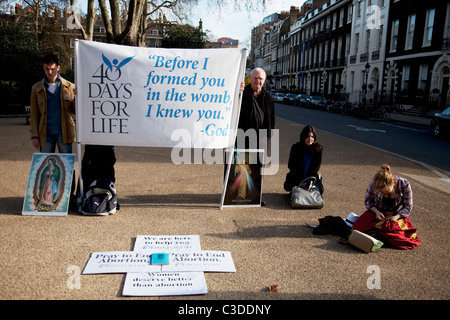 Members of 40 Days For Life protest outside a private abortion clinic. This is an anti abortion or pro life organisation. - Stock Photo