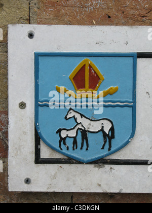 Sign showing city crest, Ely - Stock Photo