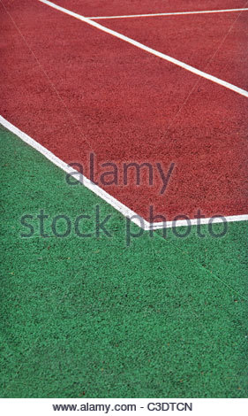 Tennis playground made with red and green gravel. Tennis court - Stock Photo