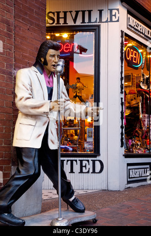 Singing Elvis Presley statue outside gift shop in downtown Nashville Tennessee USA - Stock Photo