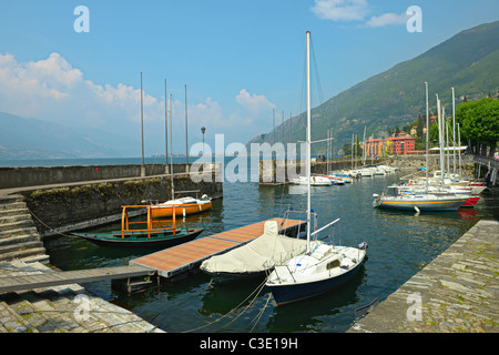 Saling boats moored in Bellano harbour on the lake front, Lake Como, Lombardy, Italy, Europe - Stock Photo