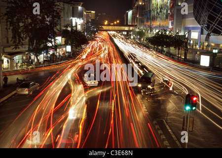 night traffic jam at siam square district in bangkok, thailand - Stock Photo