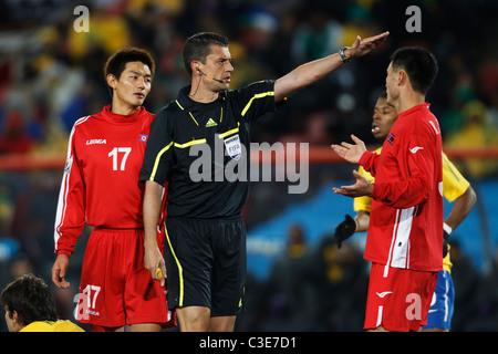 Referee Viktor Kassai gestures for a Brazil free kick during a 2010 FIFA World Cup football match between Brazil - Stock Photo