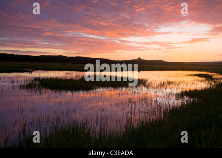 Sunset reflected in Bunduff Lough, Mullaghmore, County Sligo, Ireland. - Stock Photo