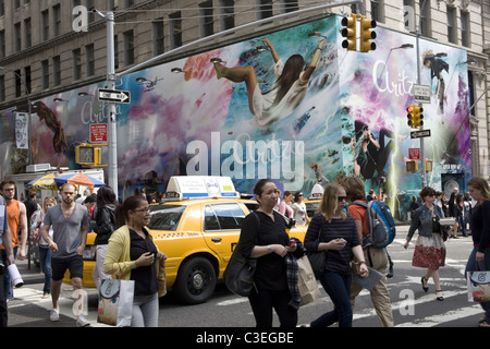 The sidewalks are always crowded in the trendy SOHO neighborhood in NYC. - Stock Photo