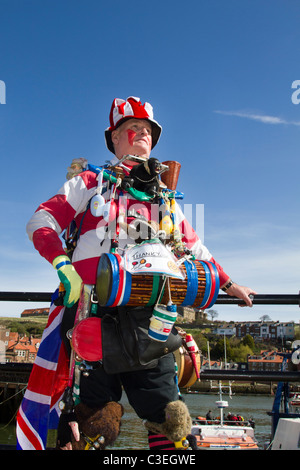Quirky Oddball, Eccentric Street Musician, Busker & travelling entertainer. Victorian one man band playing drums - Stock Photo
