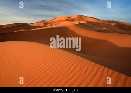 Early morning light on the massive dunes of Erg Chebbi near Merzouga in Morroco - Stock Photo
