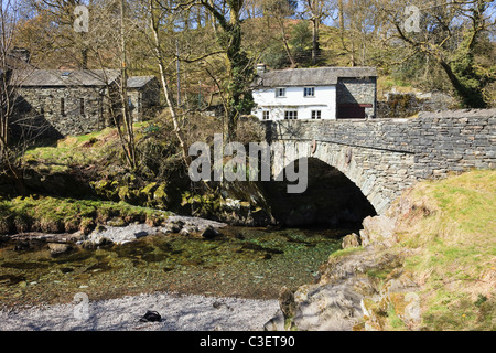 Old stone bridge over Great Langdale Beck in Elterwater, Lake District national park, Cumbria, England, UK, Britain. - Stock Photo