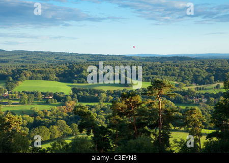 View from St Martha's church over the Surrey Hills, summer evening, hot air balloon in the distance, Surrey, England - Stock Photo