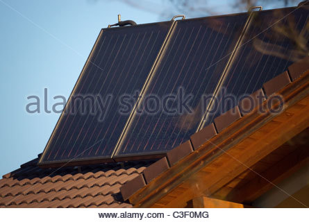 Solar panels on the roof of a private home - Bavaria Germany - Stock Photo