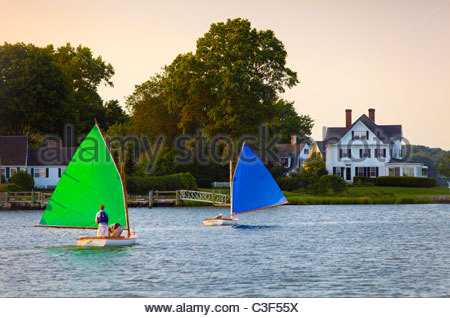 Historic wooden catboats [Beetle Cats], racing in the Mystic River. Mystic, Connecticut. - Stock Photo