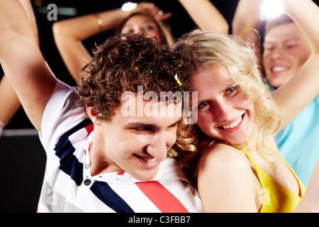 Portrait of happy couple having fun in a night club