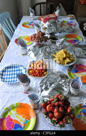 A table laid for a child's birthday party - Stock Photo