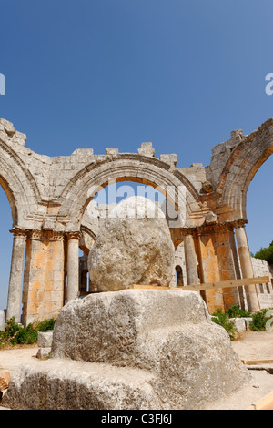 Syria. View of the stub of the once tall column in which St Simeon lived on until his death at the Church of Saint - Stock Photo