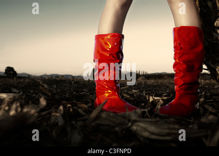 Woman wearing wellington boots, low section - Stock Photo