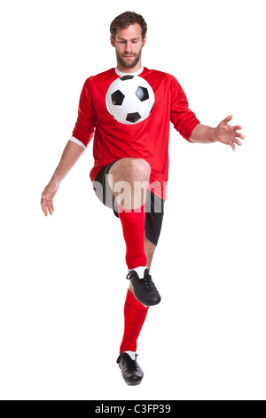 Photo of a footballer or soccer player cut out on a white background,. - Stock Photo