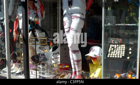 shop window, Brighton, with bric-a-brac and mannequin