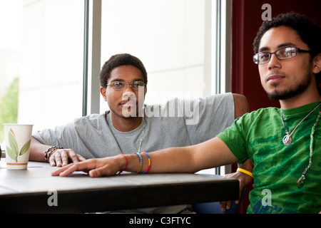 Friends hanging out in cafe - Stock Photo