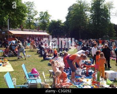 The traditional april 30th queen's day flea market attracts a huge crowd. Valkenberg park, Breda, the Netherlands - Stock Photo