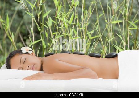 Woman getting lastone therapy - Stock Photo