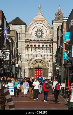 People in front of a church in market, St. Ann's Church, Dublin, Republic of Ireland - Stock Photo