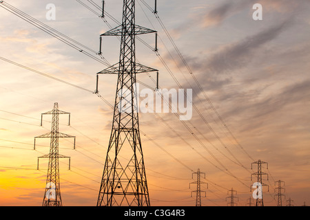 Power lines and pylons at sunset in Billingham, Teeside, UK. - Stock Photo
