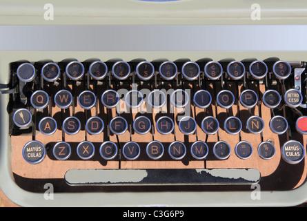 ancient aged typewriter vintage retro qwerty keyboard spanish - Stock Photo