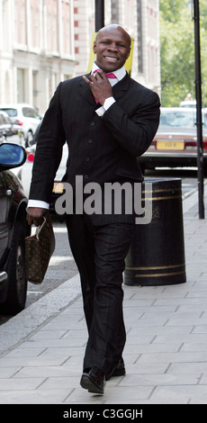 Chris Eubank dressed smartly in a pin striped suit and pink tie while out in central London. London, England - 29.08.09 - Stock Photo