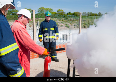 Workers in the offshore industry practice fire fighting as part of an industry training course, - Stock Photo