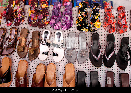 Slippers on display in an indian shop - Stock Photo