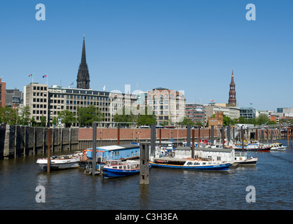 St. Nikolai church, St. Katharinen church and customs harbour viewed from the old warehouse distrct  Speicherstadt - Stock Photo