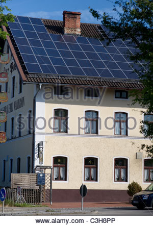 Solar panels on the roof of a pension or hotel - Bavaria Germany - Stock Photo