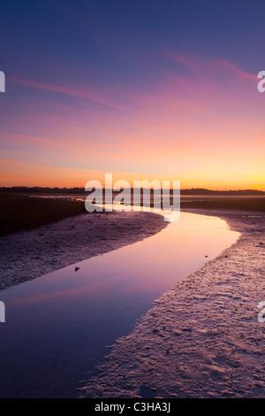 Low tide sunset over the River Moy tidal flats, County Sligo / Mayo border, Ireland. - Stock Photo