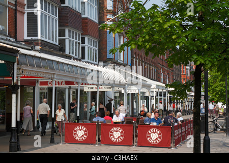 Pavement cafe on tree lined Lord Street in Southport, Merseyside, Lancashire, England, UK. - Stock Photo