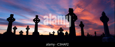 Celtic crosses in a cemetery at sunset, Enniscrone, County Sligo, Ireland. - Stock Photo
