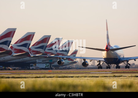 Fleet of British Airways airliners at London Heathrow Airport UK - Stock Photo